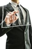 Uomo di affari che indica al grafico Fotografia Stock Libera da Diritti