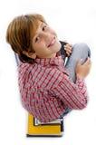 Punto di vista superiore del ragazzo con il mucchio dei libri Fotografia Stock Libera da Diritti