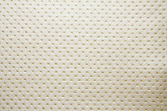 Artificial fabric texture punto 19659 golden color dotted Royalty Free Stock Image