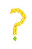 Punto interrogativo fatto dalle pillole Fotografia Stock