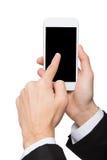 Punto maschio della mano sullo schermo in bianco del telefono cellulare Fotografia Stock Libera da Diritti
