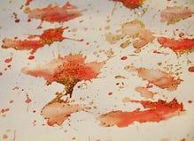 Puntos anaranjados cerosos chispeantes Fondo ceroso del invierno fotos de archivo