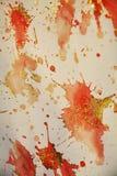 Puntos anaranjados rojos cerosos chispeantes Fondo ceroso del invierno imagen de archivo
