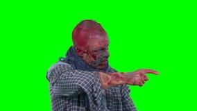 Puntos asustadizos del zombi en el finger de la esquina superior derecha almacen de video