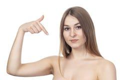 Puntos atractivos de la mujer a sí misma imagen de archivo