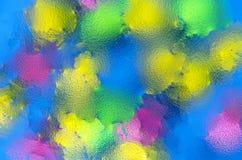 Puntos borrosos color en un fondo azul marino Imagen de archivo libre de regalías