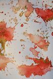 Puntos chispeantes anaranjados borrosos y sombras del oro rojo Fondo ceroso del invierno Foto de archivo libre de regalías