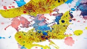 Puntos chispeantes azules amarillos rosados coloridos borrosos, fondo ceroso, diseño creativo Imagen de archivo libre de regalías