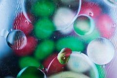 Puntos coloreados brillantes y descensos Foto de archivo libre de regalías