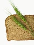 Puntos del trigo y rebanada del pan Imagenes de archivo