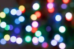 Puntos ligeros borrosos en noche de la oscuridad de Navidad Fotos de archivo