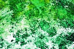 Puntos románticos fosforescentes verde oscuro que pintan el fondo de la acuarela, fondo de pintura abstracto de la acuarela fotos de archivo libres de regalías