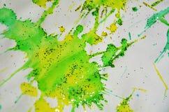 Puntos verdes chispeantes amarillos borrosos, fondo ceroso, diseño creativo Imagenes de archivo