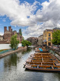 Punts lined up on river in  Cambridge England Stock Photography