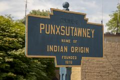 Punxsutawney, Pennsylvania town sign. Sign for Punxsutawney, Pennsylvania, home of Punxsutawney Phil, Groundhogs Days official furry prognosticator, on sunny stock photography