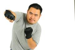 Punzone dell'uomo nel combattimento del corpo Fotografia Stock