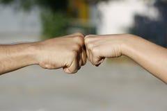 Puño al tacto del puño Imagen de archivo libre de regalías