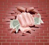 Puño del dinero que perfora a través de la pared Imágenes de archivo libres de regalías