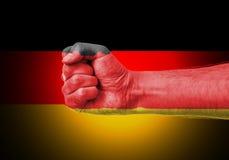 Puño sobre la bandera de Alemania Imagen de archivo