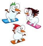 Pupazzi di neve di snowboard Fotografie Stock
