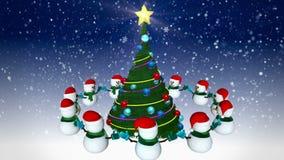 Pupazzi di neve intorno all'albero di Natale stock footage