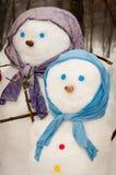 Pupazzi di neve nell'inverno Fotografie Stock Libere da Diritti