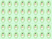 Pupazzi di neve su verde Fotografie Stock