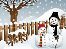 Pupazzi di neve in un paese Immagini Stock