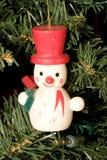 Pupazzo di neve & cappello rosso Fotografia Stock Libera da Diritti