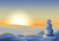 Pupazzo di neve che esamina tramonto Immagine Stock