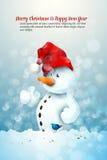 Pupazzo di neve con il cappello della Santa Immagini Stock