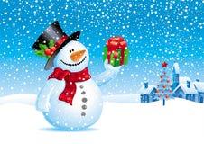 Pupazzo di neve con il regalo per voi Fotografia Stock Libera da Diritti