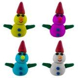 Pupazzo di neve con la mano ed il cappello su bianco Fotografie Stock
