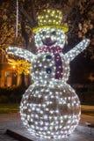 Pupazzo di neve con le luci di Natale Immagini Stock Libere da Diritti