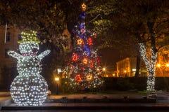 Pupazzo di neve con le luci di Natale Fotografia Stock