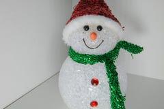 Pupazzo di neve del giocattolo con di illuminazione colorata multi Decorazione anno di nuovo e di natale Immagini Stock
