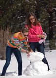 Pupazzo di neve della costruzione della donna Immagini Stock