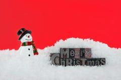 Pupazzo di neve dello scritto tipografico di Buon Natale Fotografia Stock