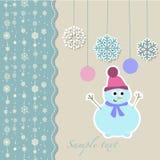 Pupazzo di neve di Natale con i fiocchi di neve decorativi Fotografie Stock