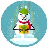 Pupazzo di neve di Natale con il regalo Immagini Stock Libere da Diritti