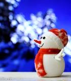 Pupazzo di neve di Natale sul fondo del bokeh Fotografie Stock