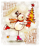 Pupazzo di neve felice con l'albero di Natale Fotografia Stock