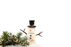Pupazzo di neve in neve Fotografia Stock
