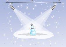 Pupazzo di neve sotto i proiettori Immagini Stock