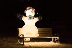 Pupazzo di neve sul banco Fotografie Stock Libere da Diritti