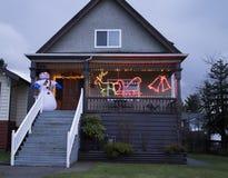 Pupazzo di neve sul portico a christmastime Fotografia Stock Libera da Diritti