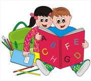Pupil. Boy and girl looking at a book. In addition to the backpack and pencils Royalty Free Stock Photography