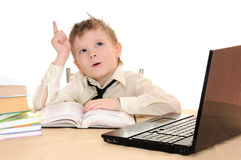 Pupil. Boy pupil thinks for in time  homework Stock Photography