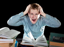 The pupil is angry about a large number of lessons Royalty Free Stock Images