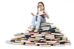 Pupil on books Stock Images